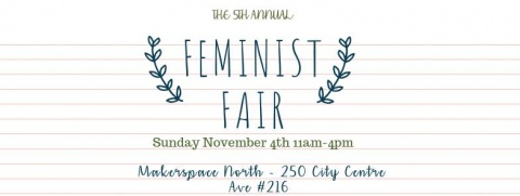"Image says ""5th Annual Feminist Fair"" with the text surrounded by a floral wreath."